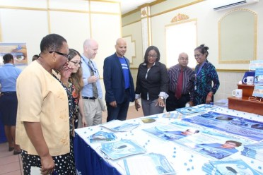 Persons viewing the material to be used in the campaign at the launch.