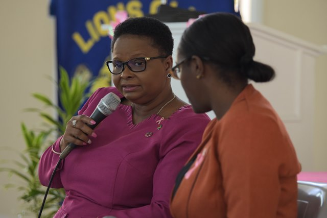 Minister Lawrence at a breast cancer awareness lecture for high school students at St. Rose's High School.