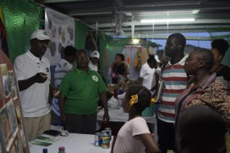 Calvin Hector explaining his products to patrons