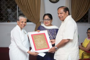 Prime Minister Moses Nagamootoo and his wife Mrs. Sita Nagamootoo being presented a token from Sister Usha at the Raj Yoga Center