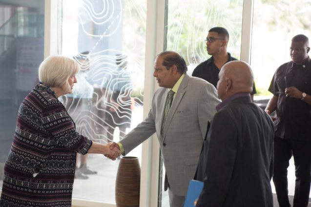 Prime Minister and Acting President, Moses Nagamootoo greets Chief Executive Officer, CAPAM, Gay Hamilton