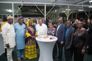 Prime Minister Moses Nagamootoo, who is currently performing the functions of the President, and Mrs. Sita Nagamootoo pose with the delegation from South Africa during the reception