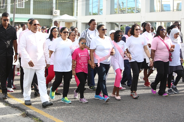 Prime Minister Moses Nagamootoo, his wife Sita Nagamootoo, Minister of Public Health Volda Lawrence, First Lady Sandra Granger and Minister within the Ministry of Public Health Dr. Karen Cummings along with two young participants of the breast cancer awareness walk.