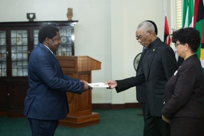 High Commissioner of the United Republic of Tanzania, Dr. Emmanuel John Nchimbi presents his letter of commission to President David Granger.