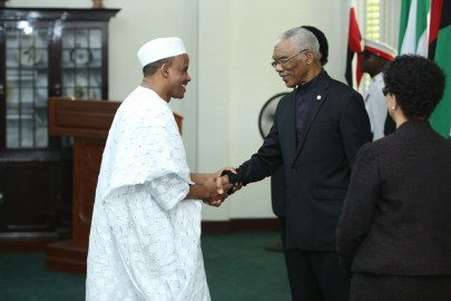 High Commissioner of the Federal Republic of Nigeria, Alhaji Hassan Jika Ardo exchanges a handshake with President David Granger.