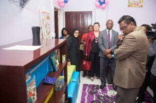 Minister of Public Security Khemraj Ramjattan checking out some of the books placed inside of the Children's Court.