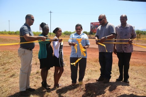 [left to right] Chief Executive Officer (CEO) of GO-Invest, Owen Verwey, Deputy Mayor of Lethem, Maxine Welch-Hendricks, Regional Chairman, Brian Allicock cutting the ribbon with Mayor of Lethem, Kerry Jarvis and Ambassador of Guyana to Brazil, George Talbot.