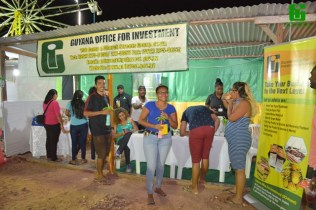 Residents of Lethem and visitors to GO-Invest's booth participating in the Agency's QUIZ on Investment sectors.