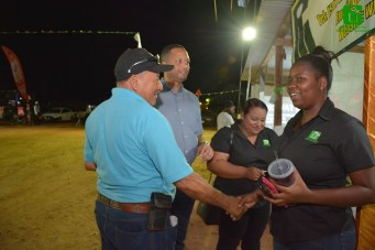 Minister of Amerindian Affairs, Mr. Sydney Allicock greets staff of GO-Invest as CEO Mr. Owen Verwey looks on.
