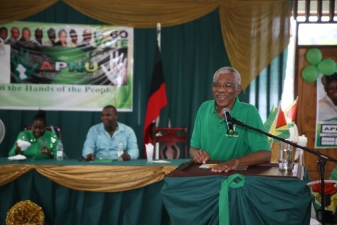 President David Granger smiles during his address to the gathering at the community meeting.