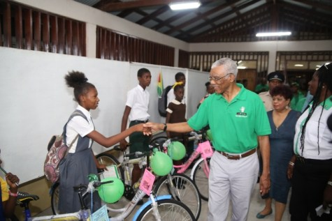 President David Granger greeting a student who benefited from his Five Bs Initiative.