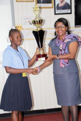 Ulancy Emanuel of the Linden Special Needs Centre receiving her first place trophy from the Director of NCERD, Ms. Jennifer Cumberbatch.