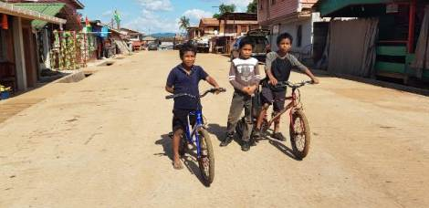 Young boys enjoying a bike ride on one of the internal roads in Mahdia.
