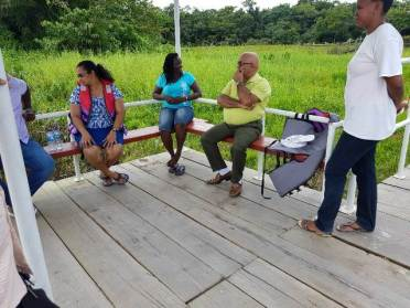 Regional Executive Officer (REO), Denis Jaikaran in discussion with residents at Endeavour.