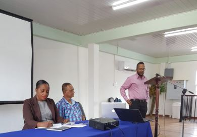 Regional Health Officer Dr. Dudhnath at the podium during the IHSDN workshop. Seated are Director of Regional Health Services Dr. Kay Shako and Regional Chairman, Julius Faerber