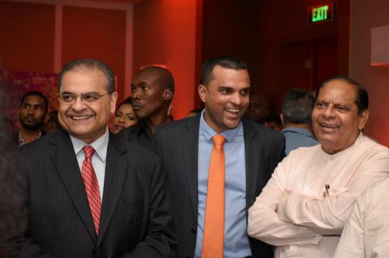 E-Networks Chairman H.R Puri, Chief Executive Officer Vishook Persaud and Prime Minister Moses Nagamootoo sharing a light moment at the company's 15th anniversary cocktail