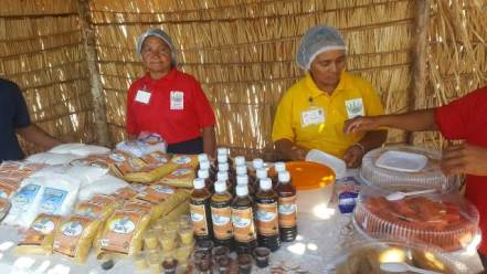 Two members of the Wowetta Women's Agro-processers group showcasing their products.