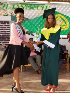 Second-runner up in the Miss World Guyana, Joylyn Conway awarding the second-best graduating student, Sheneze Barkoye, who attained a diploma in Science.