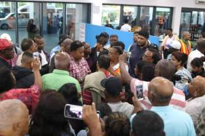 Minister within the Ministry of Public Infrastructure, Annette Ferguson meeting with passengers.