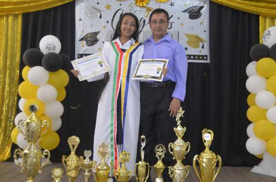 Valedictorian, Christina Albert proudly supported by her father