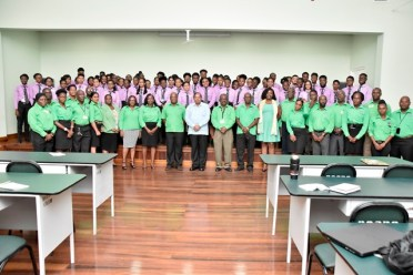 Prime Minister Nagamootoo stands with the staff and cadets of the BCCPS.