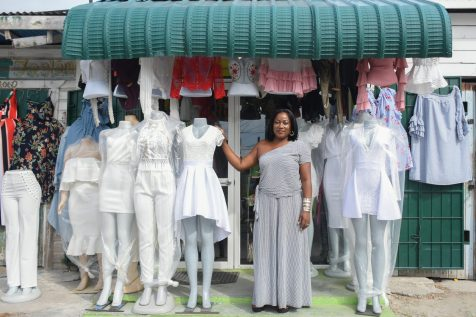 Owner of The Fashion Box, Samantha Glasgow poses in front of her Bourda and Charlotte Streets outlet