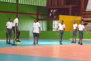 Some of the students warming-up before they begin the game of football.