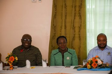 [In the photo, from left to right] At the head table, Chief Education Officer of the Ministry of Education, Marcel Huston, Minister of Education, Dr. Nicolette Henry and Coordinator of the Mental Health Unit at the Ministry of Public Health, Travis Freeman.
