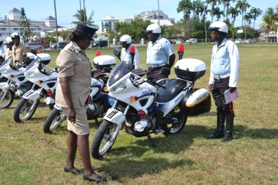 Deputy Commissioner of Operations, Maxine Graham conducting the first inspection of the Chinese donated vehicles at Eve Leary Ground.