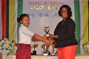 Most Promising Actress, Rea Fernandes of North-West Secondary receiving her award from Administrator (ag) of the Unit of Allied Arts Lorraine Barker-King