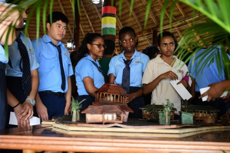 School students at an exhibit