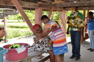 Minister of Public Health, Volda Lawrence and the birthday senior.