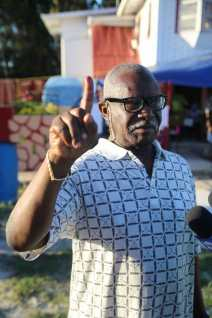 Minister of Citizenship, Winston Felix showing his inked finger after casting his vote