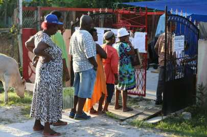Voters waiting at a polling station in Georgetown to cast their votes for the LGE