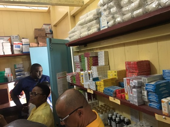 Drugs and other supplies being examined and verified by Minister of Public Health, Volda Lawrence and her team.