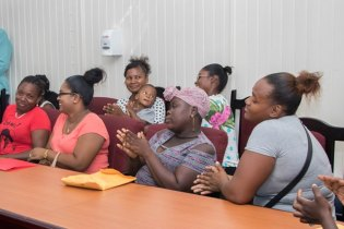 Some of the 'C' Field Sophia Residents who met with Minister Adams-Yearwood and the CH&PA team.