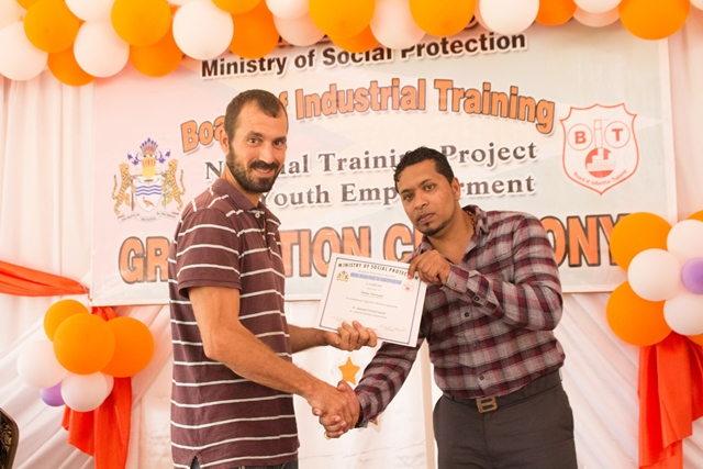 Peter Henyan receiving his certificate from Essequibo Technical Institute Rawle Pearce.