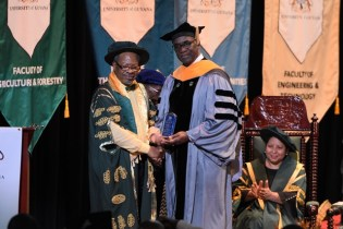 Professor Norman Munroe from the Florida International University receives a token of appreciation from UG's Vice Chancellor, Professor Ivelaw Griffith, after delivering the second charge to graduates.
