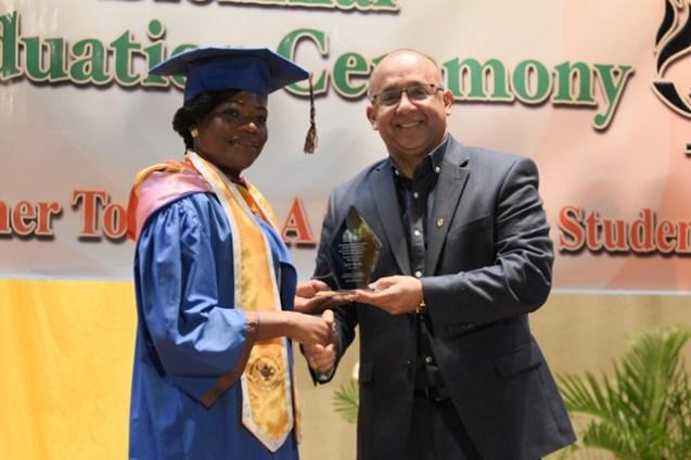 Valedictorian, Leola Charles receives her various awards.