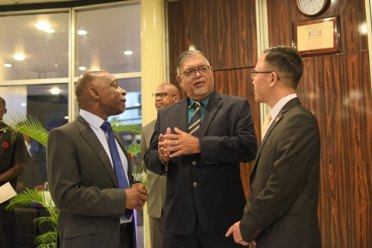 Guyana's Honorary Consul to South Korea, Ramesh Dookhoo, interacting with Minister Greenidge and Chargé d'affaires Dong-il Oh.