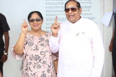 Prime Minister Moses Nagamootoo and his wife, Mrs. Sita Nagamootoo proudly display their inked fingers after voting.