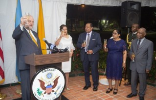Outgoing US Ambassador to Guyana, Perry Holloway raise a toast in the presence of his wife, Prime Minister Moses Nagamootoo and his wife, Mrs. Sita Nagamootoo and Minister of Foreign Affairs, Carl Greenridge.