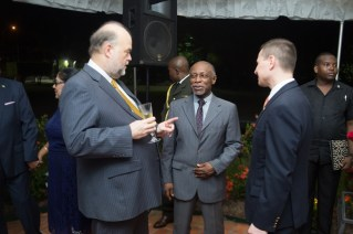 Minister of Foreign Affairs, Carl Greenidge, who is performing the functions of Prime Minister, in discussion with Ambassador Holloway and Deputy Chief of Mission at the US Embassy in Guyana, Terry Steers-Gonzalez.