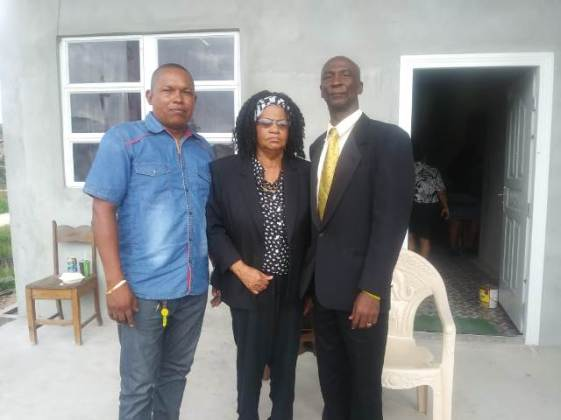 Newly-elected Chair and Vice Chair of the NDC the Kwakwani Elsie McPherson [centre] and Cort Simeon [left], pose with Regional Vice-Chairman Elroy Adolph [right].