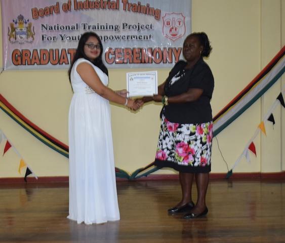 A graduate receiving her certificate.