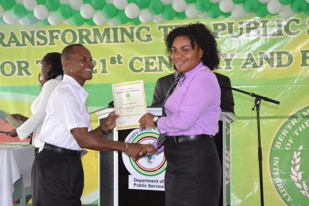 Some of the graduating students receiving their certificates