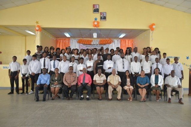 (seated front row third from left) Regional Information Officer Ganesh Mahipaul, Region Three Vice-Chairman Sheik Ayube, Regional Education Officer (Region Three) Anesta Douglas and Regional Executive Officer, Dennis Jaikarran along with other officials and the graduates.
