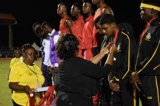 Athletes receiving their medals for their outstanding performance at the National School's Championship.