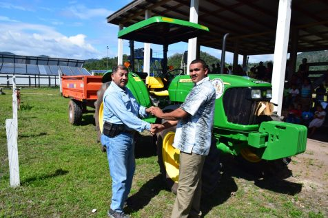 Minister of Indigenous Peoples' Affairs, Sydney Allicock handing over the keys to a tractor to outgoing chairman of Aranaputa, Adon Jacabus