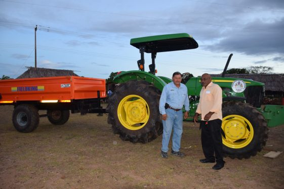 Minister of Indigenous Peoples' Affairs, Sydney Allicock handing over the keys to a tractor to Toshao of St. Ignatius, Dennis Benedict